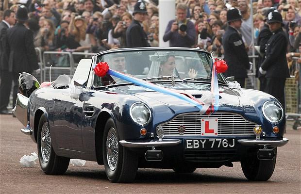 Duke and Duchess of Cambridge leave Buckingham Palace in an Aston Martin