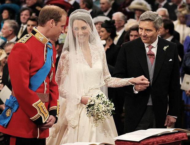 Kate and William share a smile at the altar