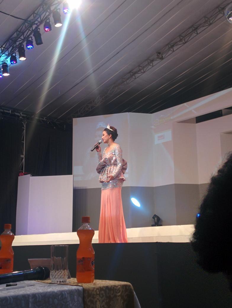 Miss Nepal 2014 Subin Limbu speaks a few words before passing on the crown