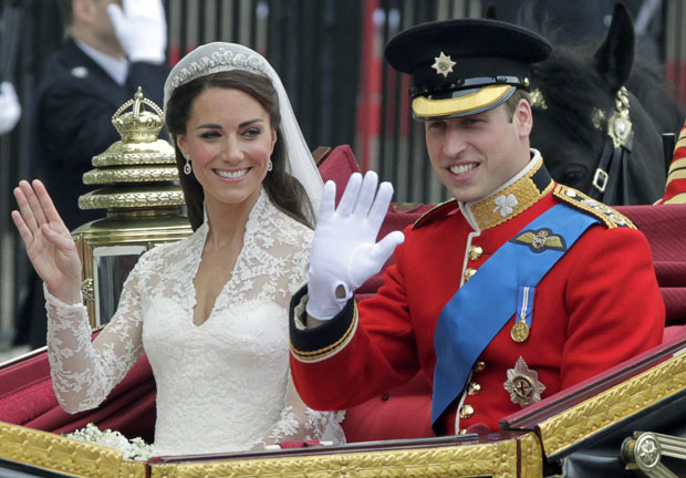 Prince William and his wife Kate, Duchess of Cambridge wave
