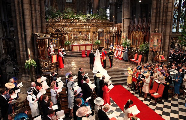 William stands beside his bride Kate during their wedding service